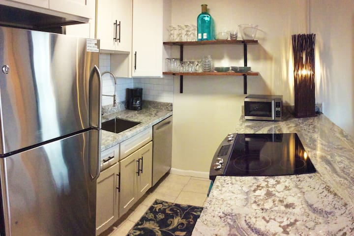Kitchen features stainless steel appliances and a ceramic-topped electric range