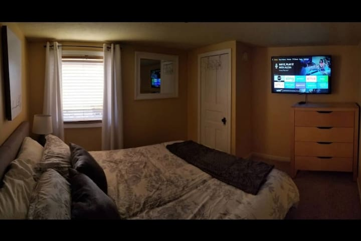Queen sized bed with smart TV downstairs