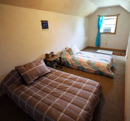 """Upstairs loft with two TWIN beds. This is the """"third"""" bedroom."""