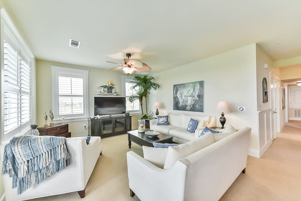 Living Area Offers Lots of Windows that Bring in Lots of Sunshine