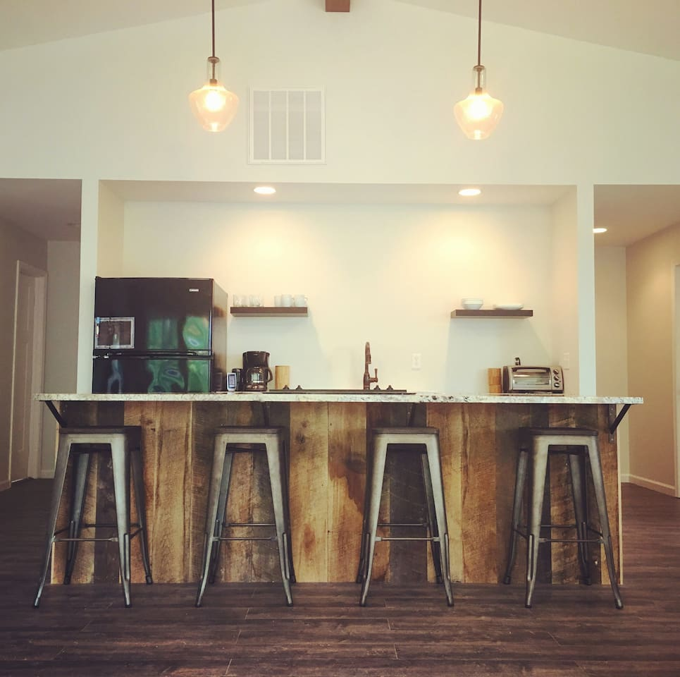 Large kitchen island made from the barn's original barn wood siding