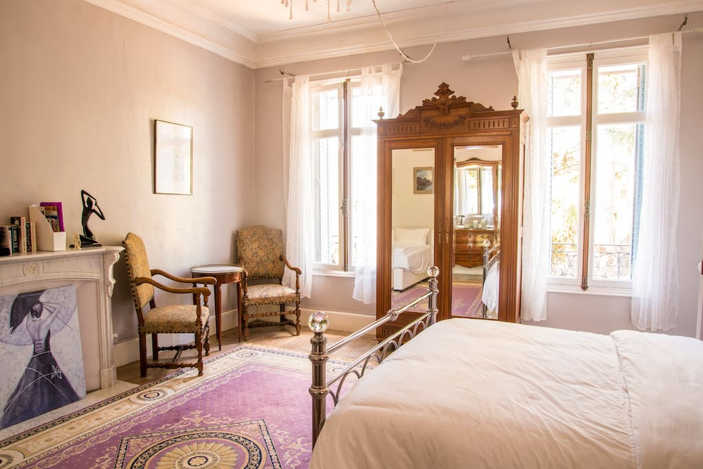 Chambre Celine, our Double bedroom with a view of the garden and swimming pool.