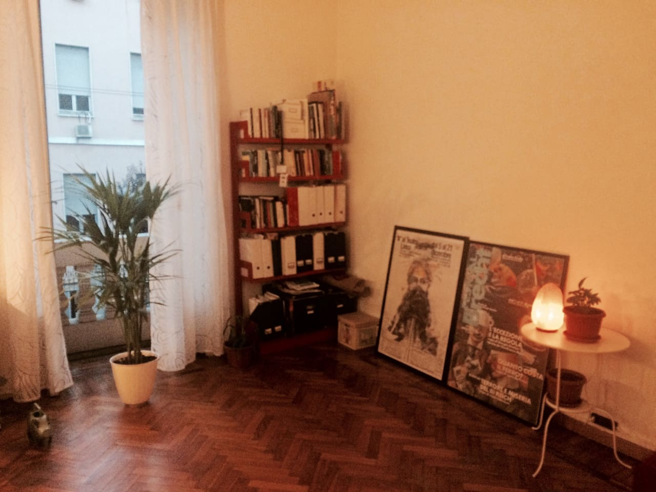 Hall/living room with a window to the silent street