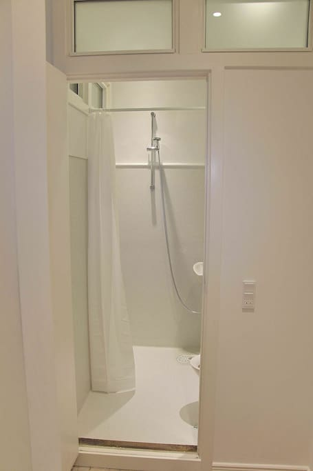 Bathroom with toilet and shower.