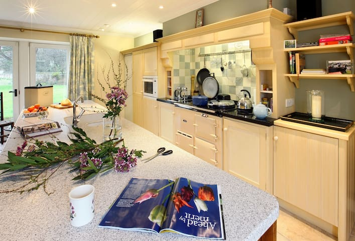 Ground floor: Kitchen with Aga and dining area with French doors to garden
