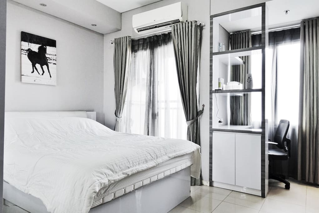 Queen Bed, Air Conditioner, Small working space, large window and shades