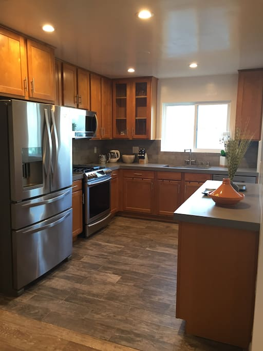 Kitchen area with brand new stainless steel appliances