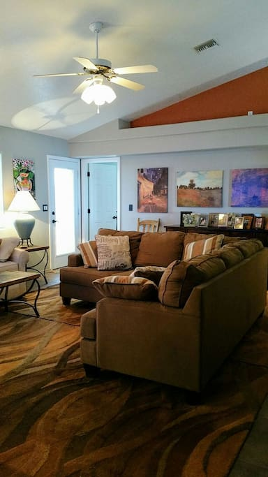 Comfortable couches for tv viewing, games, conversation, or enjoying the lake and mountain views.
