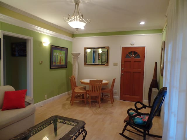 Living/dining area and front entrance door