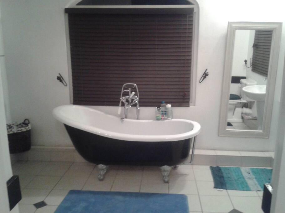 En-suite bathroom with bathtub.