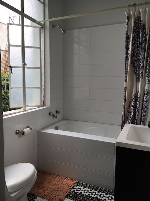 Bathroom with functioning hot tub and complimentary salts. Exclusive for our guests!