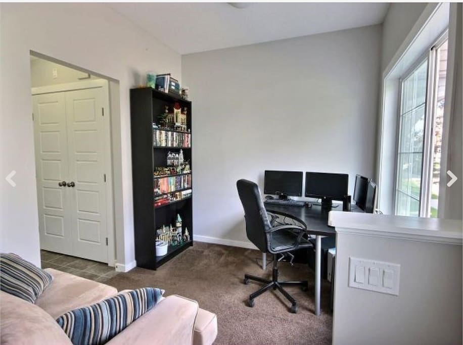 The front door opens to a small den; laundry facilities are also on this floor