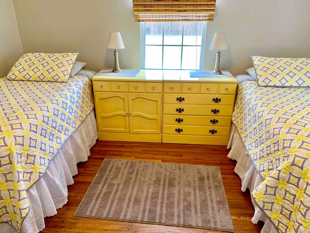 Adorable twin beds in a bright room