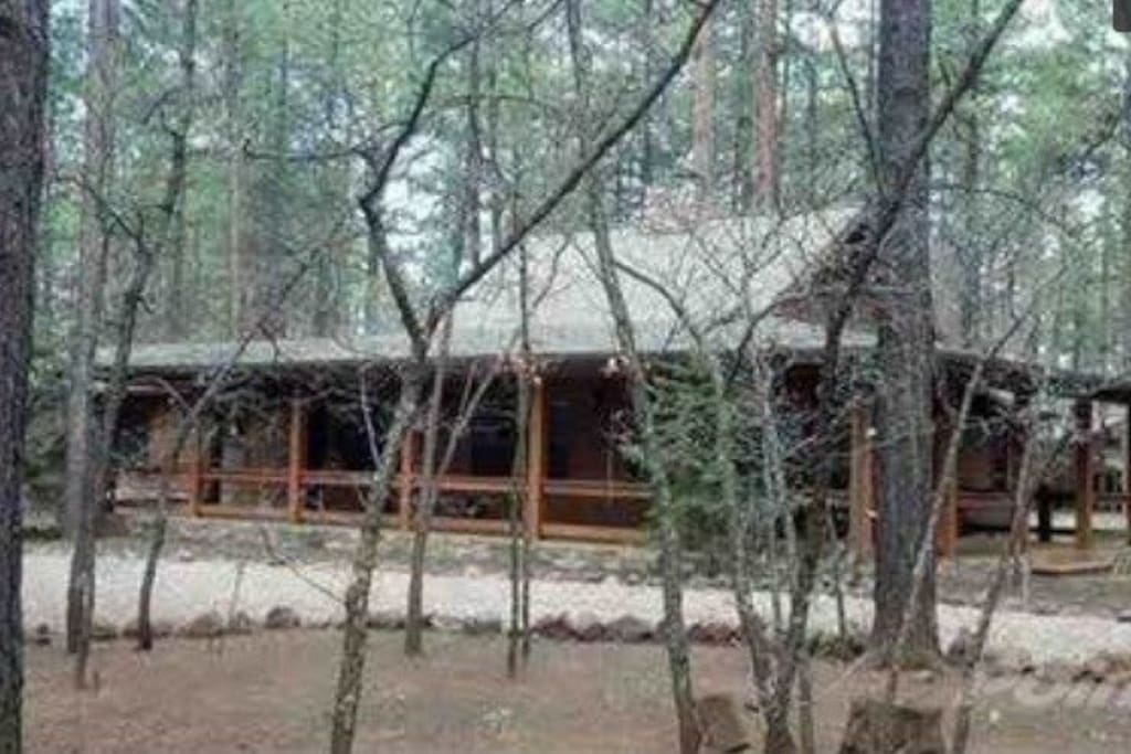 5-bedroom, 3 bath cabin in WMCC with gorgeous wrap around porch and spacious, tree-filled lot.