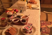Continental breakfast with fresh bread and pastries from the local boulangerie