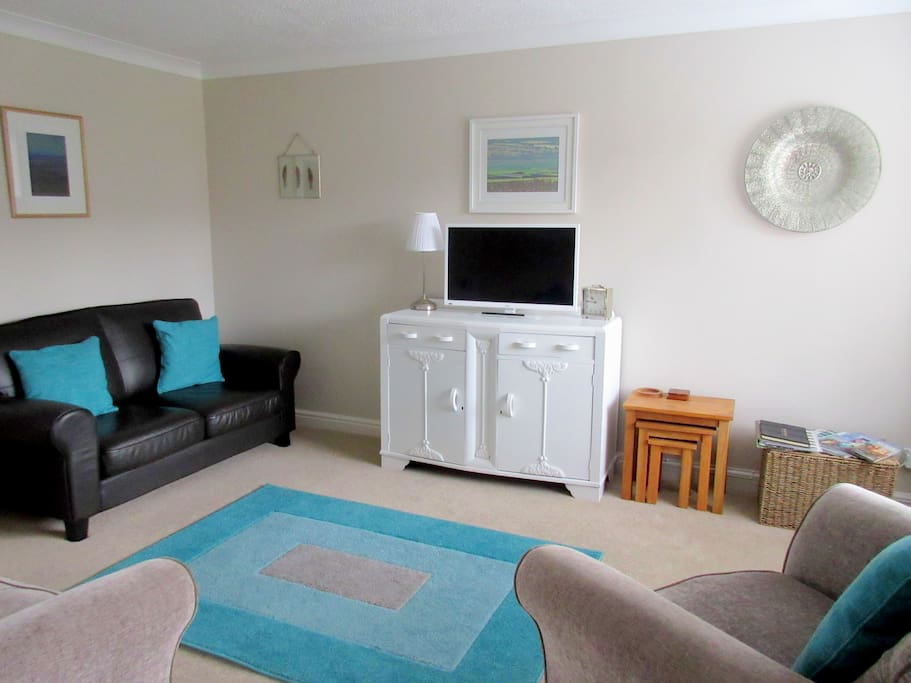 Comfortable, warm living room with real leather sofa, armchairs and hd tv with dvd player, wii console and 2 controllers plus games, freeview tv and hdmi slots (if you wish to bring amazon firestick/netflicks etc), films, books and toys.