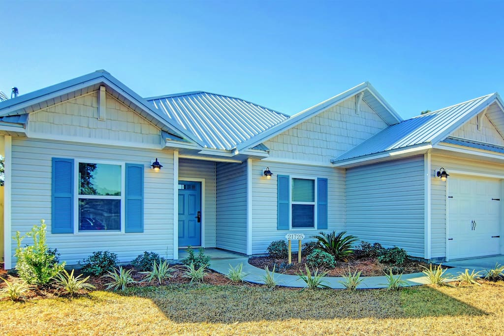 Brand new, charming, coastal cottage with 1 car garage and driveway parking.
