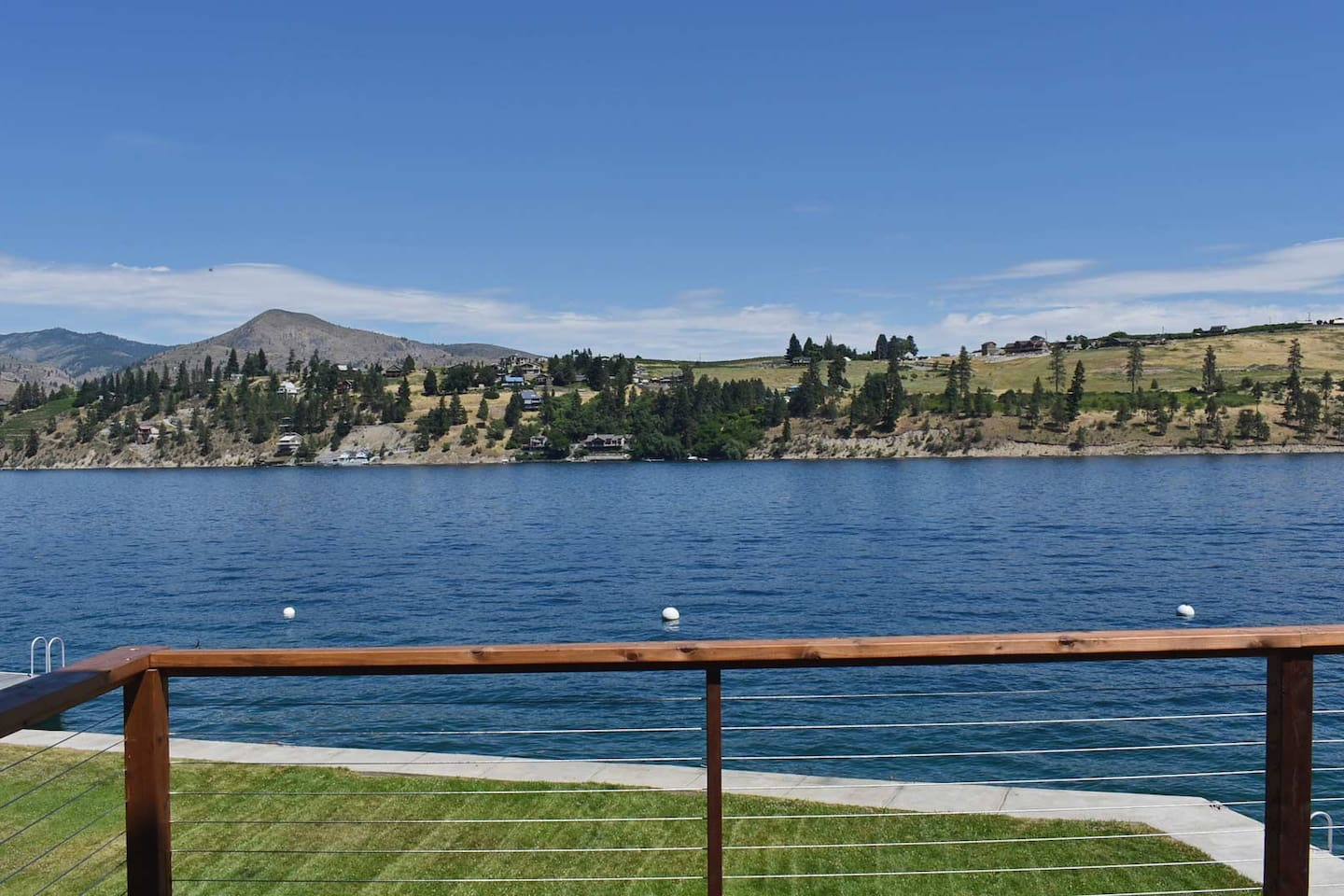 Enjoy gorgeous views and lakeside living from the new deck at this amazing waterfront home on beautiful Lake Chelan!