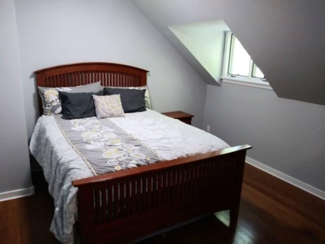 Master bedroom has a queen bed.