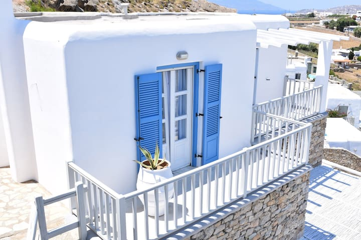 The outside of the villa is painted in the traditional blue and white colors of Mykonos