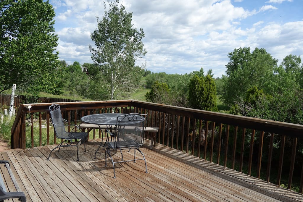 Enjoy morning coffee or afternoon cook out from the back deck overlooking open space