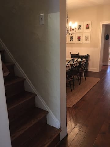 Stairs to the second floor with two bedrooms and a full bath.