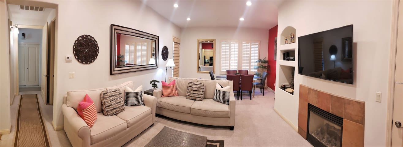 03. Living Room Ariel View - Featuring flat screen TV, dining room and an access to private patio