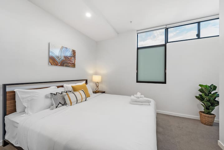 Air conditioned bedroom with ultra-comfy King bed and wardrobe