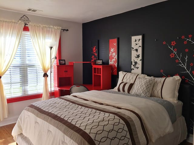Queen Bed with Shared Bathroom