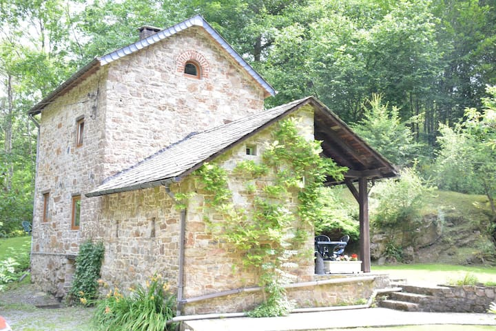 Cottage in the countryside, in the middle of the Ardennes forest,romantic garden