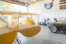 Inside the hangar with the cub Isetta and Shelby cobra. Notice the segues on the back wall..
