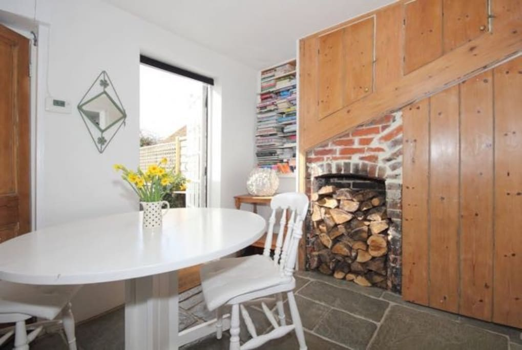 Dining area with flagstone floor and original features
