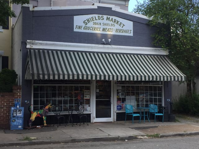 Shields Market is right out our back gate. They open at 8 AM (close at 11 pm)  and have great coffee brewed if you don't feel like making it in the room. They also have a good selection of craft beers and wine, along with prepared foods and lots of other stuff.