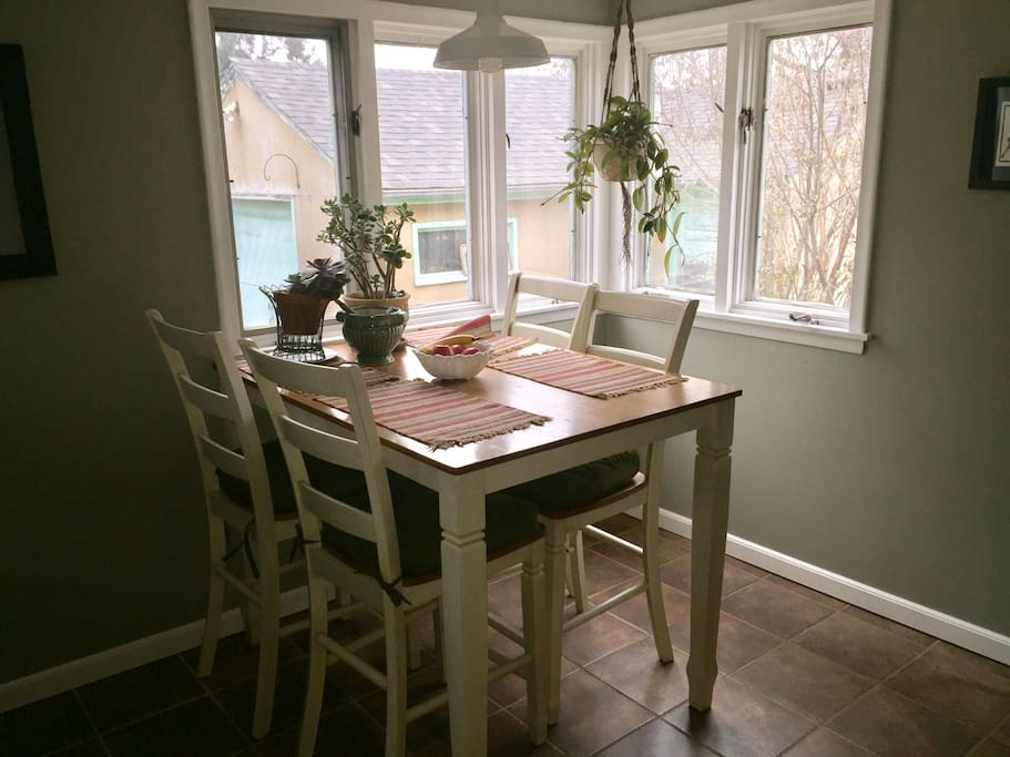 Breakfast nook with a view of the private backyard oasis. This is the perfect laptop coffee station.