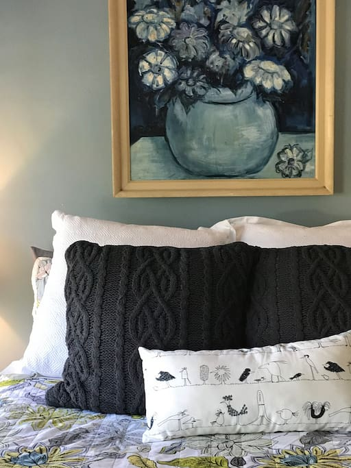 Queen bed covered with stateen sheets for coolness in the summer and thick warm blankets in the winter.