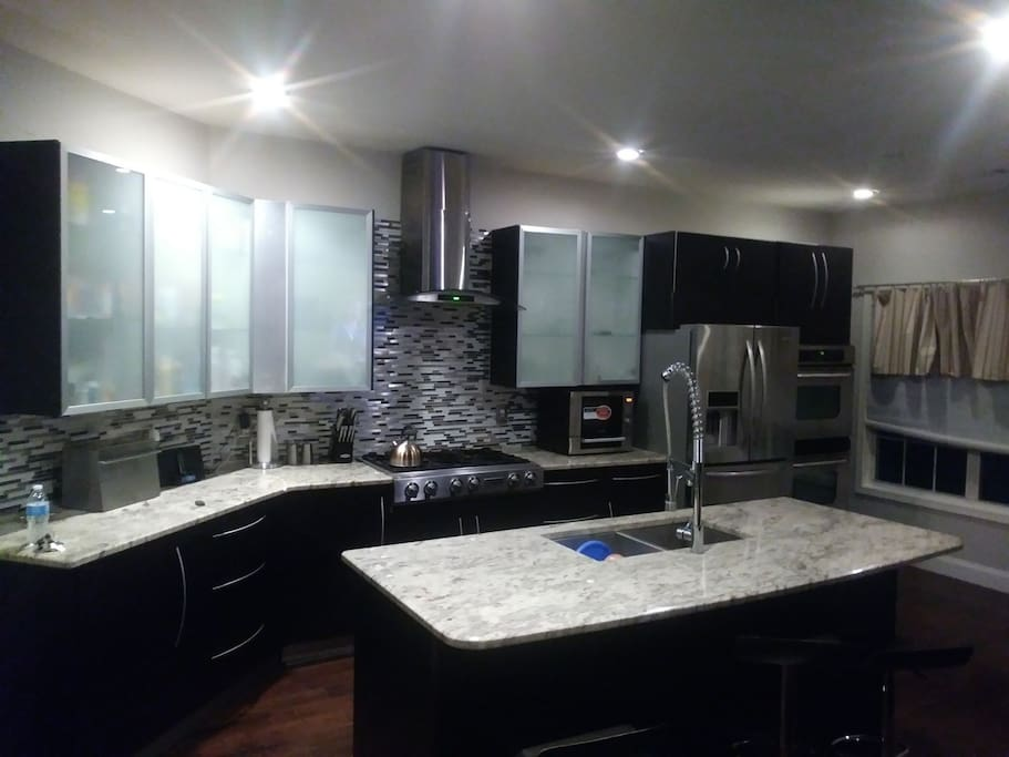 modern kitchen furnished with all amenities.