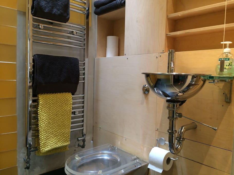 lovely wetroom, slate floor, grey towels, expelair and velux window