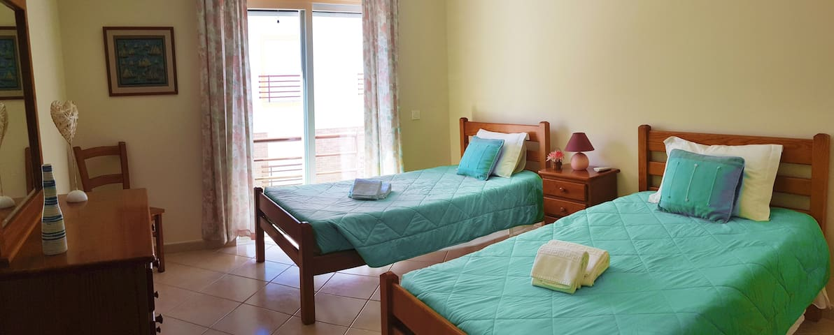 two single beds with private bathroom
