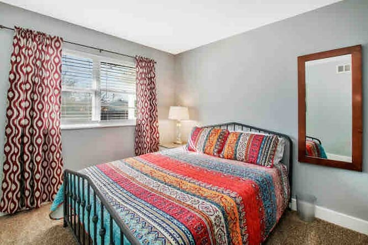 Third bedroom is outfitted with a comfortable queen bed
