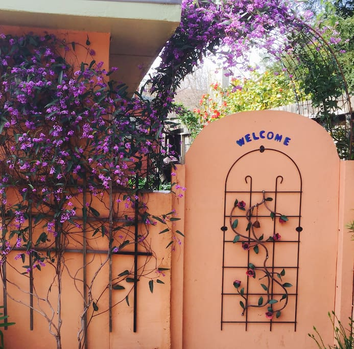 Welcome Gate thru the Garden to your  Private Entranceway