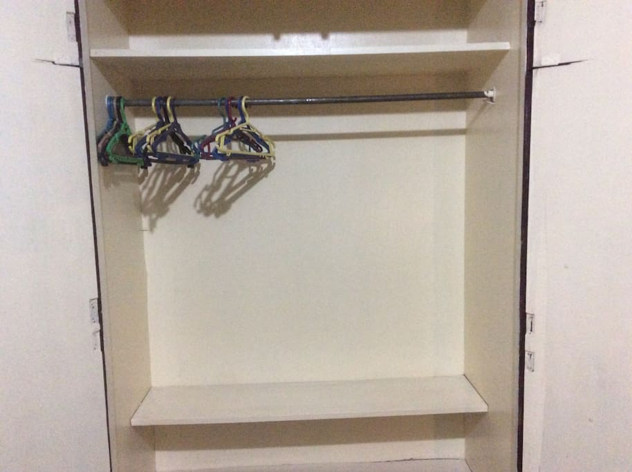 The big closet with hangers.