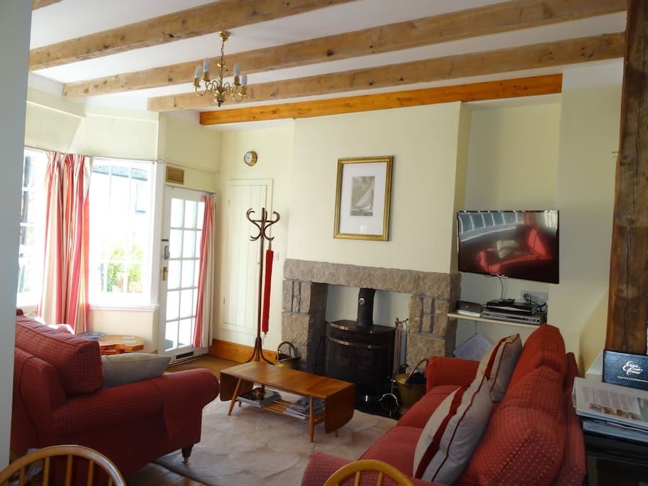 Driftwood's lounge with log burner and smart tv