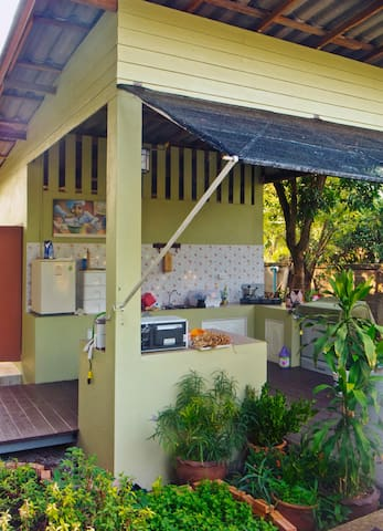 Guests may use our well equipped outdoor kitchen - washing machine, small fridge, sink, microwave, cooking hob, etc