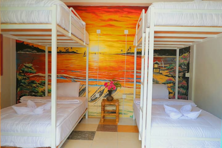 A Bed in a dorm room At the Tropical garden inn