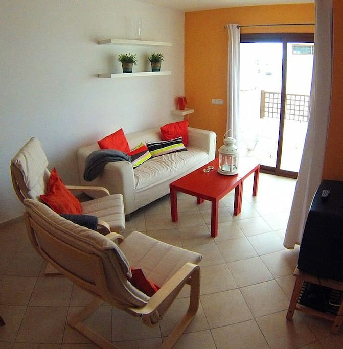 Lounge with smart TV and patio doors to sun terrace