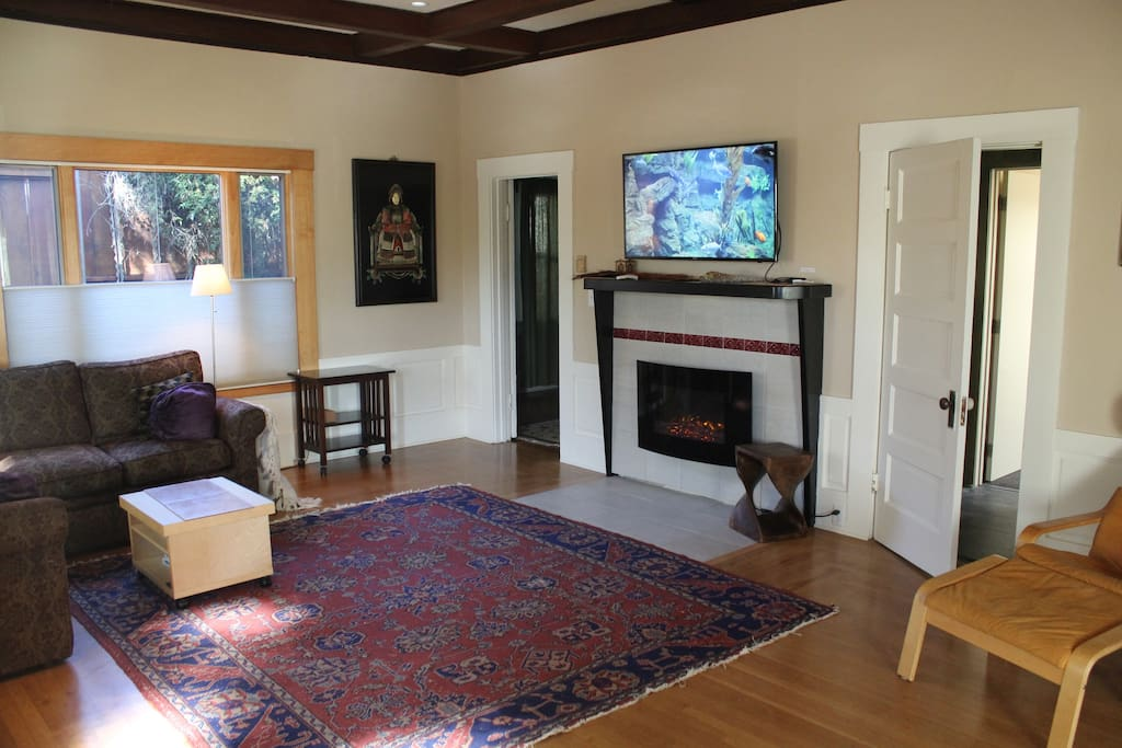 Living Room- Large screen and wall hung fireplace
