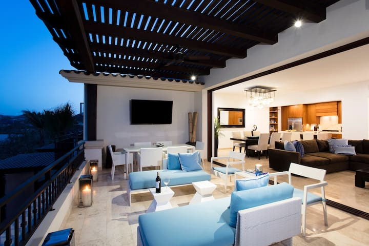 Vanishing pocket sliders open up,  offering a thoughtfully-designed layout for indoor-outdoor living.  Retreat into the rich comfort of your contemporary hacienda-style space. Can be your home away from home... A Private Luxurious Penthouse Villa.