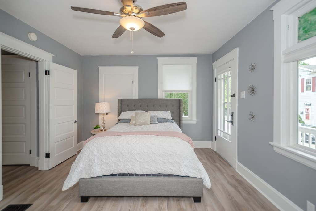 Master bedroom with a queen bed and tons of closet space.