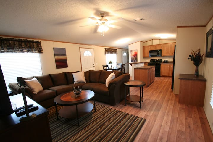"""Full living room with 46"""" flat screen TV with 150 channels"""