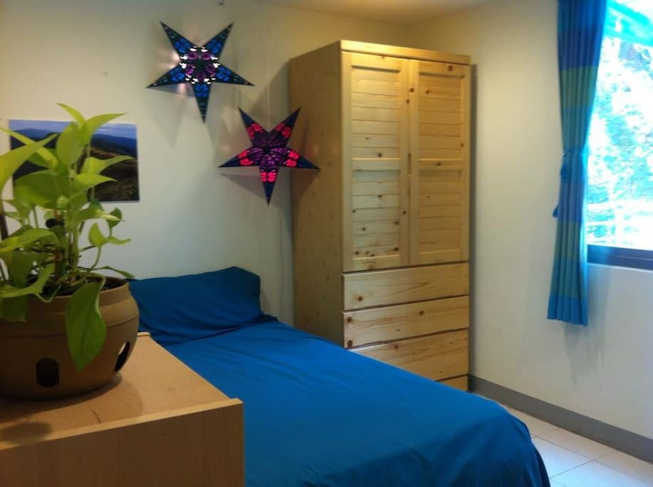 Double bed. Wooden closet with drawers.